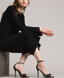 Leder-Sandalen mit Riemchen Schwarz Frau 191TCP10U-0S
