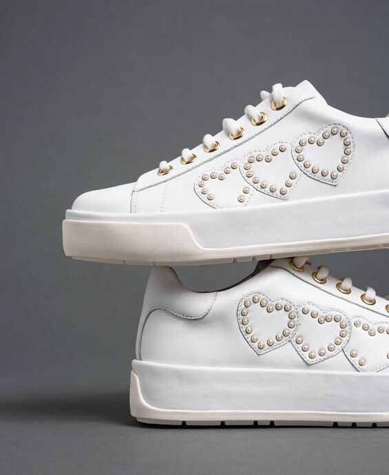 Leather trainers with hearts and studs