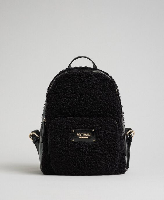 Faux fur backpack with front pocket