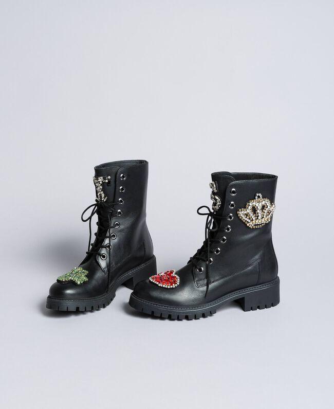 Schnürstiefelette aus Leder mit Aufnähern Schwarz Frau CA8PLN-01