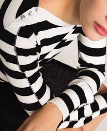 """Jumper with rhinestone buttons on the shoulders Black / """"Snow"""" White Stripes Woman 201TP3103-03"""
