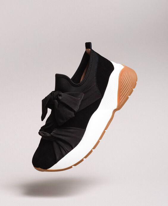 Sneakers in tessuto con maxi fiocco
