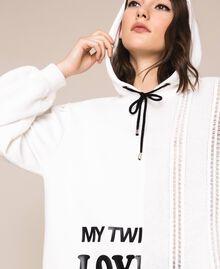 Длинная трикотажная кофта с логотипом Лилия женщина 201MP3210-05