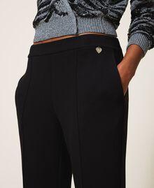 Pantalón en tejido scuba Negro Mujer 202TT2T25-05
