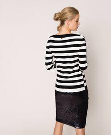 """Jumper with rhinestone buttons on the shoulders Black / """"Snow"""" White Stripes Woman 201TP3103-05"""