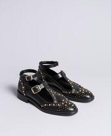 Schuh aus Leder mit Cut-outs und Nieten Schwarz Frau CA8PEU-01