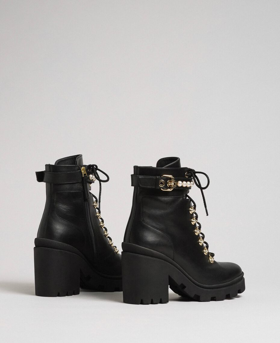 Leather combat boots with heel and pearls Black Woman 192TCP01C-03
