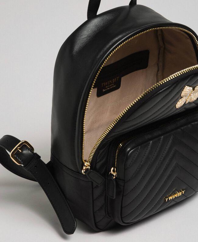 Sac à dos en cuir matelassé avec papillon-bijou Noir Femme 192TA7100-04