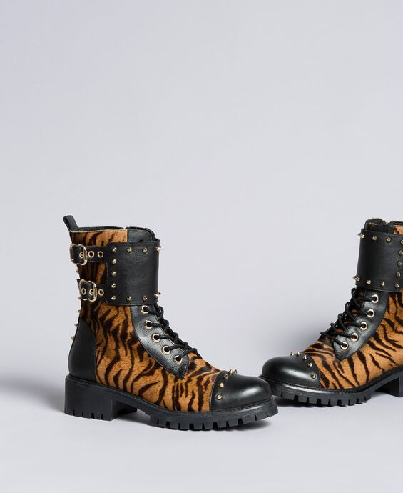 Leather combat boots with animal print inserts