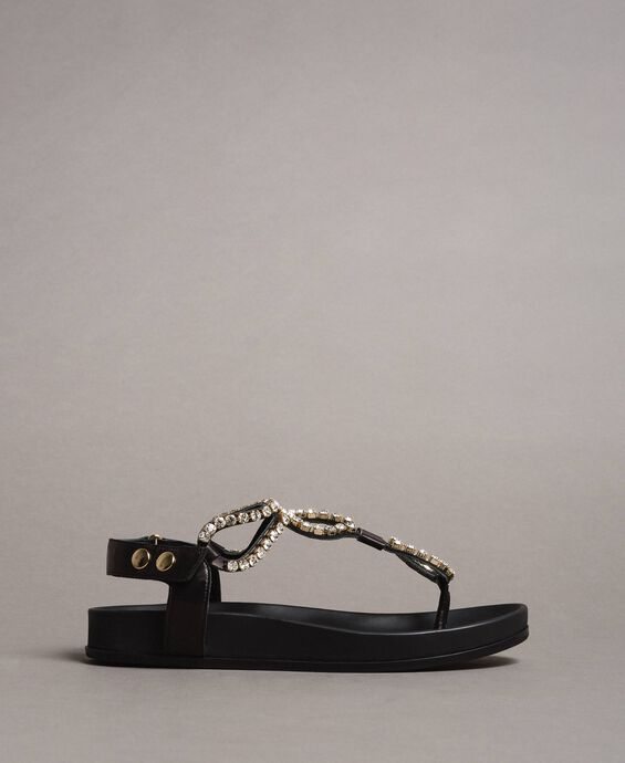 Leather sandals with rhinestones and button
