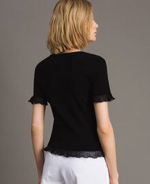 Stretched ribbed top with ruffle Black Woman 191TT3042-03