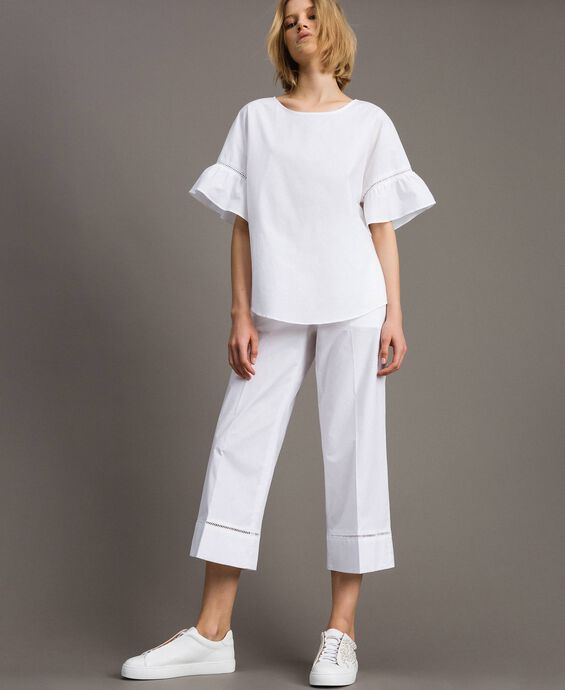 Poplin trousers with embroideries