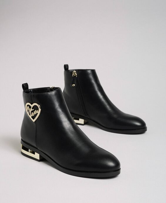 Logo ankle boots with decorative heel