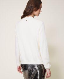 Strickjacke und Pullover mit Blumenstickerei Sahneweiß Frau 202TP3360-02