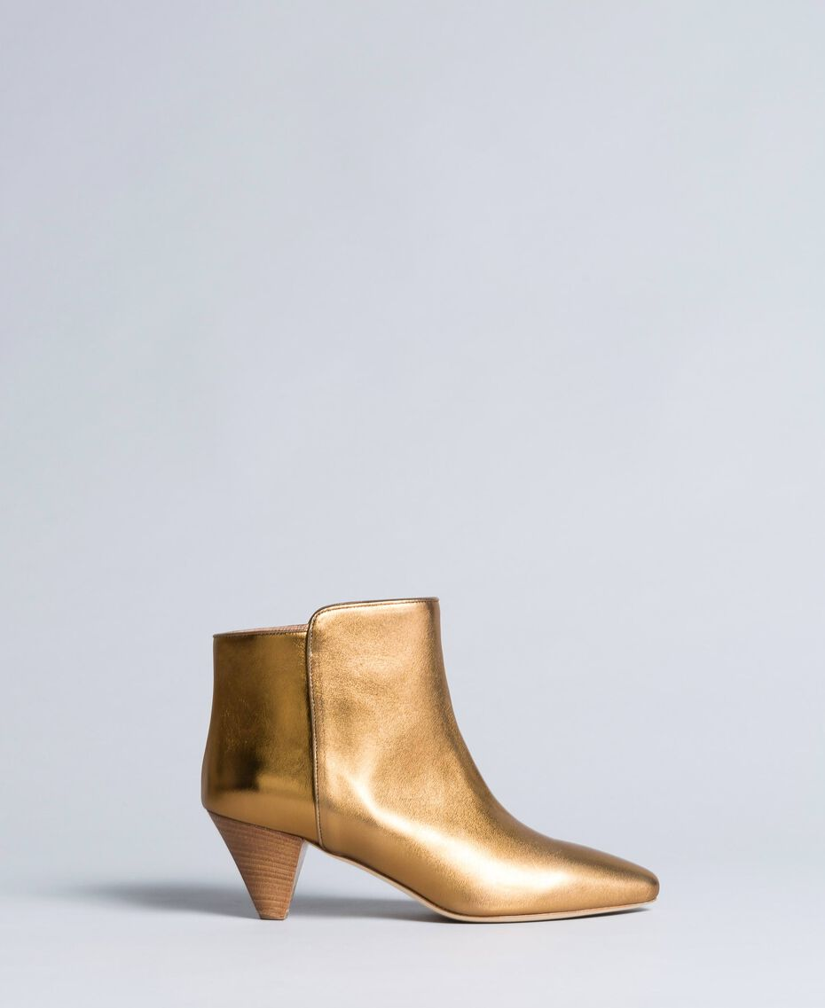 Laminated leather ankle boots Gold Yellow Woman CA8TPA-02