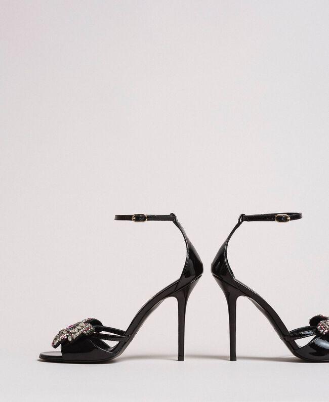 Sandales en cuir ornées d'un bijou papillon Noir Femme 191TCP104-03
