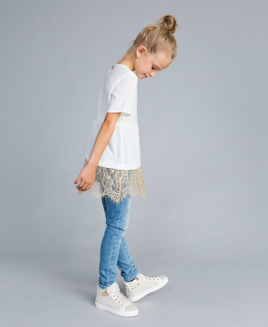 Skinny jeans with stones and rhinestones Light Denim Child GA82VN-02