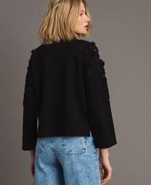 Sweatshirt mit Blumenstickapplikationen Schwarz Frau 191TT2210-03
