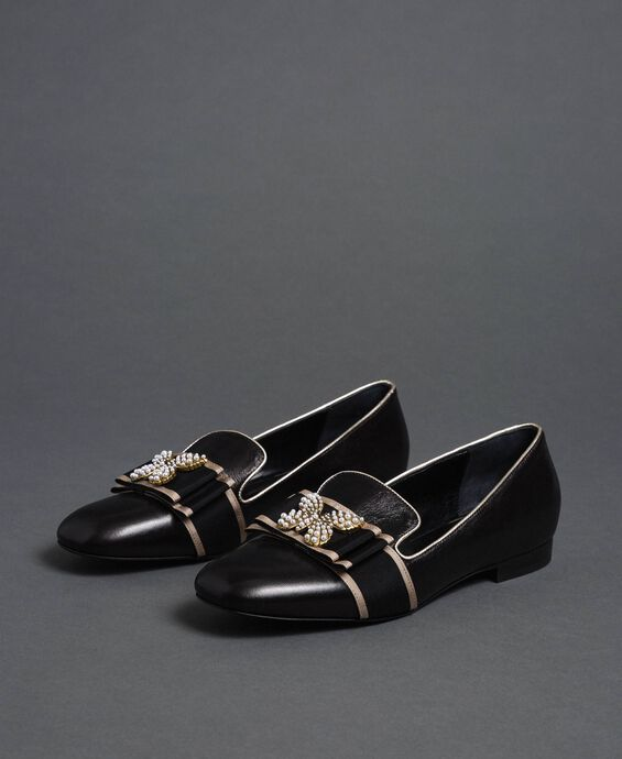 Leather loafers with embroidered band