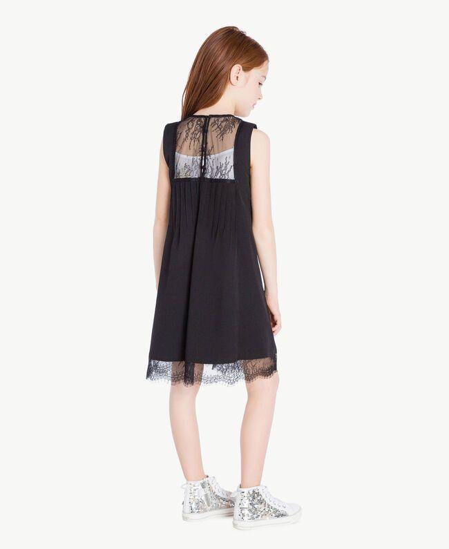 Kleid mit Spitze Zweifarbig Schwarz / Papyrusweiß Kind GS82EE-04