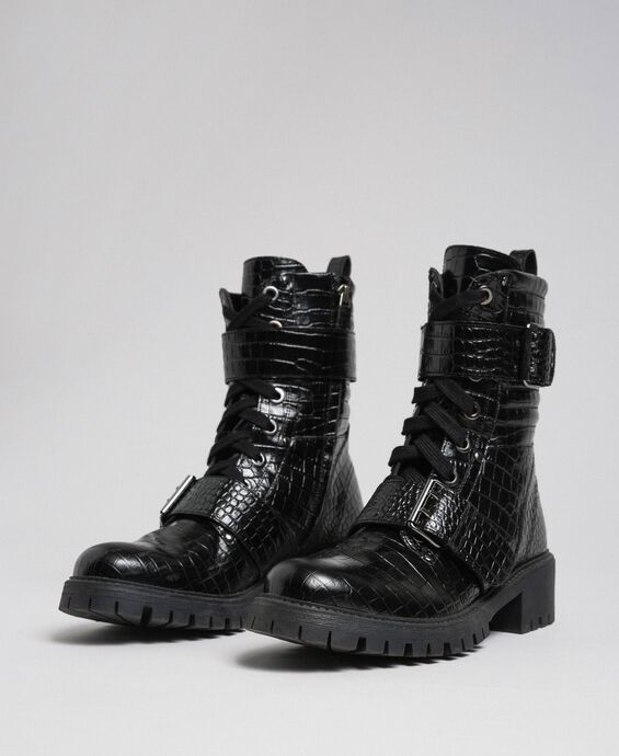 Leather combat boots with crocodile print