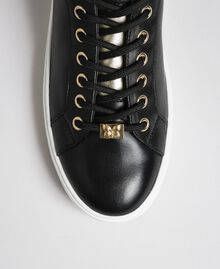 Leather trainers with contrasting details Black Woman 192TCP06E-04