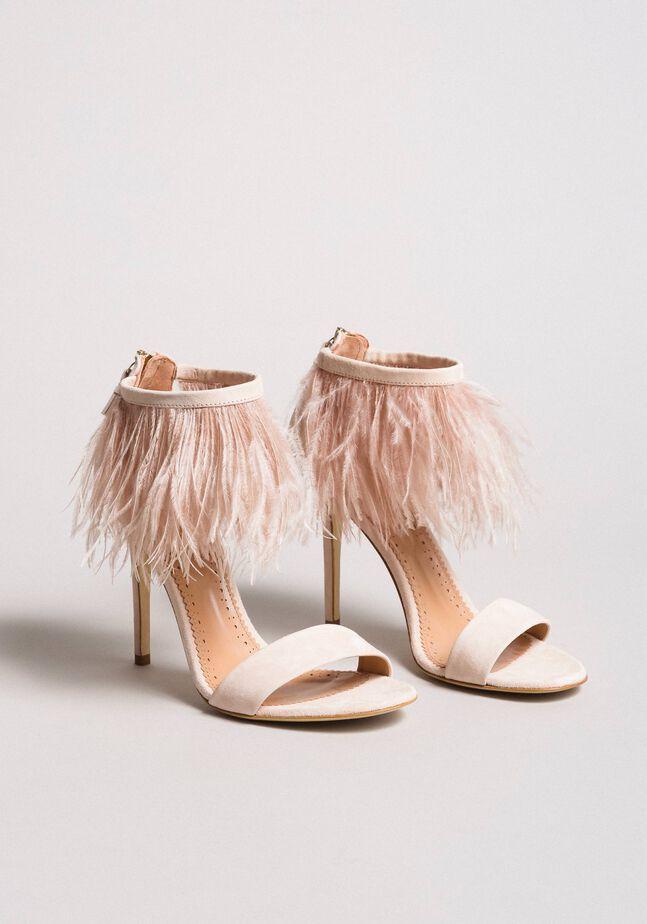 Sandali alti in pelle con piume