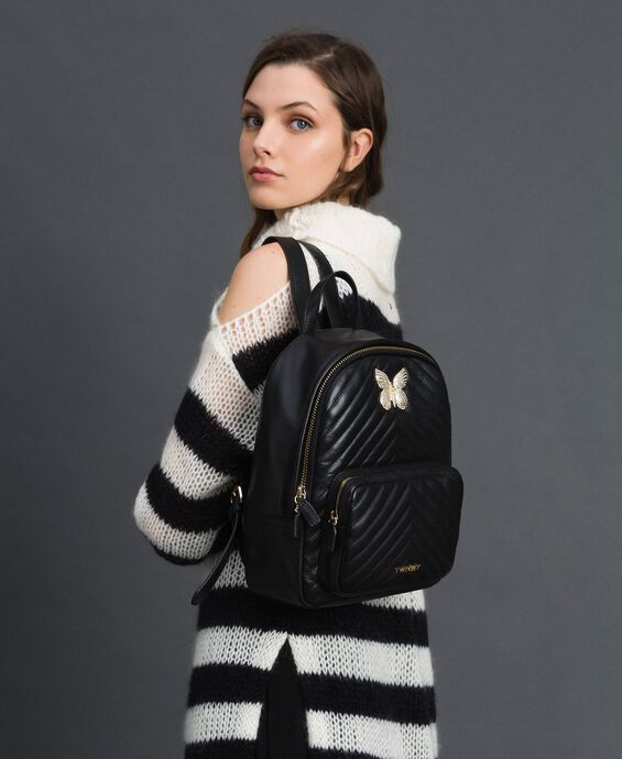 Quilted leather backpack with jewel-butterfly