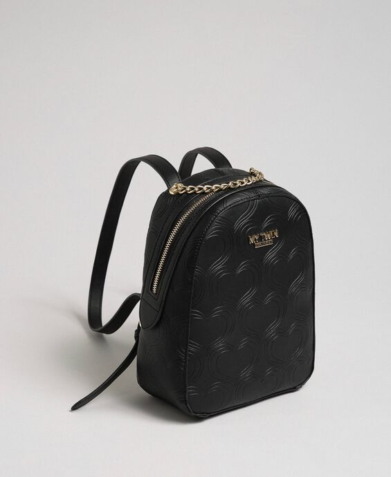 Heart print faux leather backpack