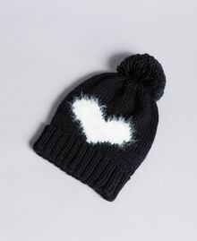 "Knitted hat with heart Bicolour ""Snow"" White / Black Woman AA8P5B-01"