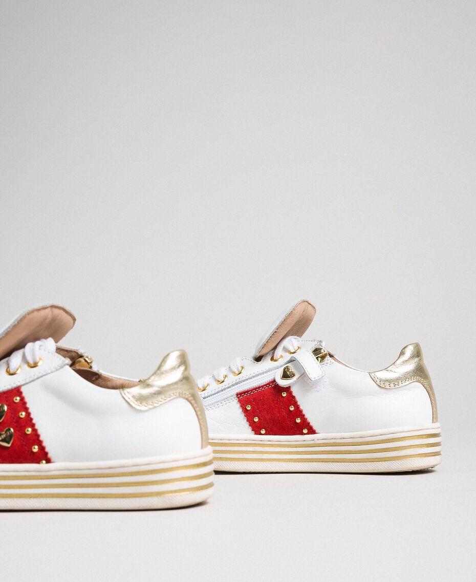 Sneakers in pelle con cuori e borchie Bianco Bambina 192GCJ012-03