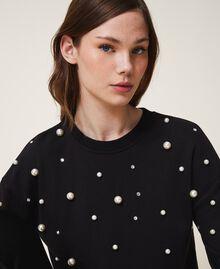 Sweatshirt mit aufgestickten Perlen Schwarz Frau 202TT2T51-01