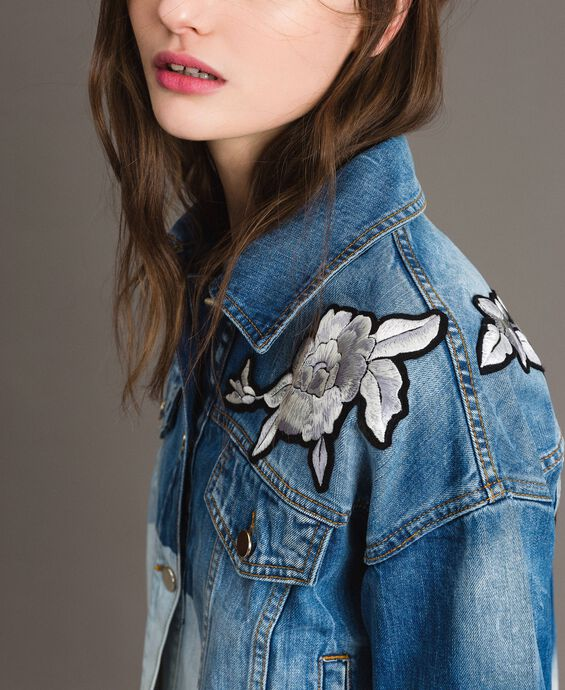 Denim jacket with floral patch