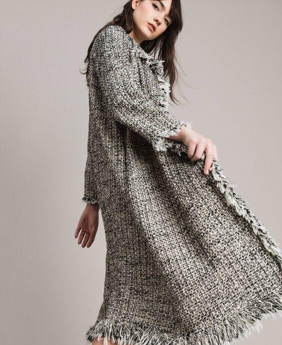 Manteau cache-poussière en tweed orné de franges