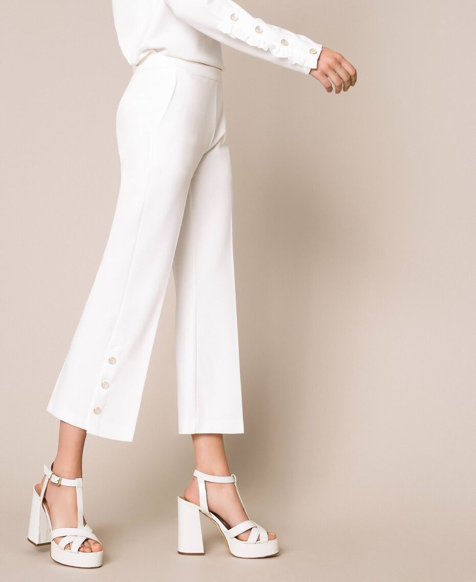Trousers with frill and pearls Ivory Woman 201TP2103-03