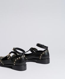 Cut-out leather shoes with studs Black Woman CA8PEU-02