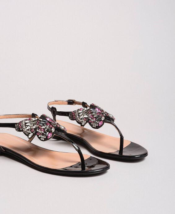 Sandalias de piel con mariposa de bisutería
