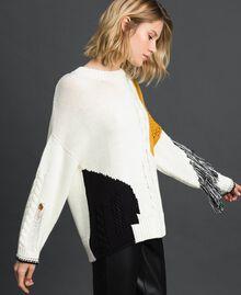 Pullover mit Zopfmuster und Fransen Vanille / Safrangelb / Schwarz Frau 192MP3041-02