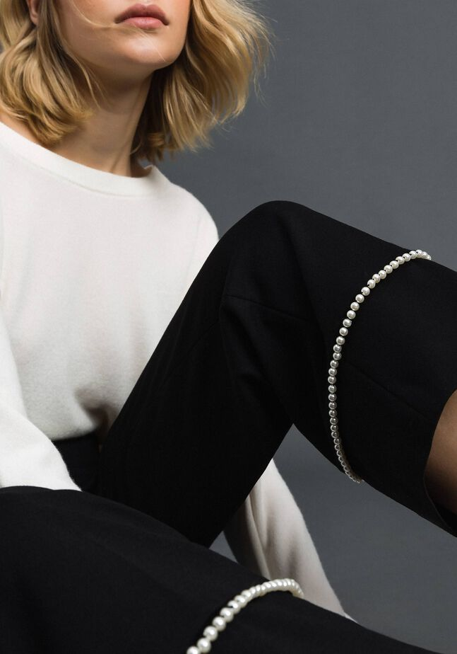 Flared trousers with pearl embroidery