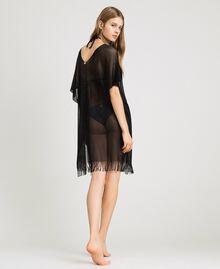 Glossy yarn poncho with fringes Black Woman 191LB44CC-03
