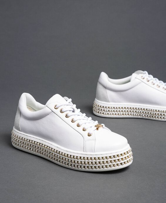Platform sole trainers with pearls