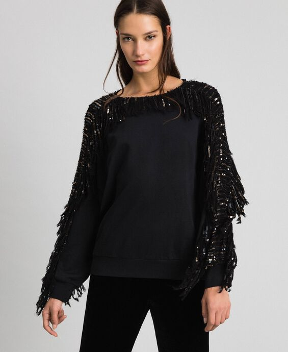 Oversize sweatshirt with sequin embroidery and fringes