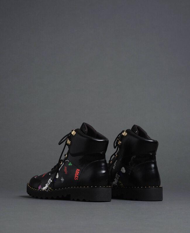 Faux leather combat boots with graffiti print Black Graffiti Print Woman 192MCP09G-04
