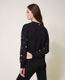 Sweatshirt mit aufgestickten Perlen Schwarz Frau 202TT2T51-03