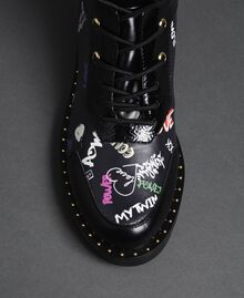 Faux leather combat boots with graffiti print Black Graffiti Print Woman 192MCP09G-03