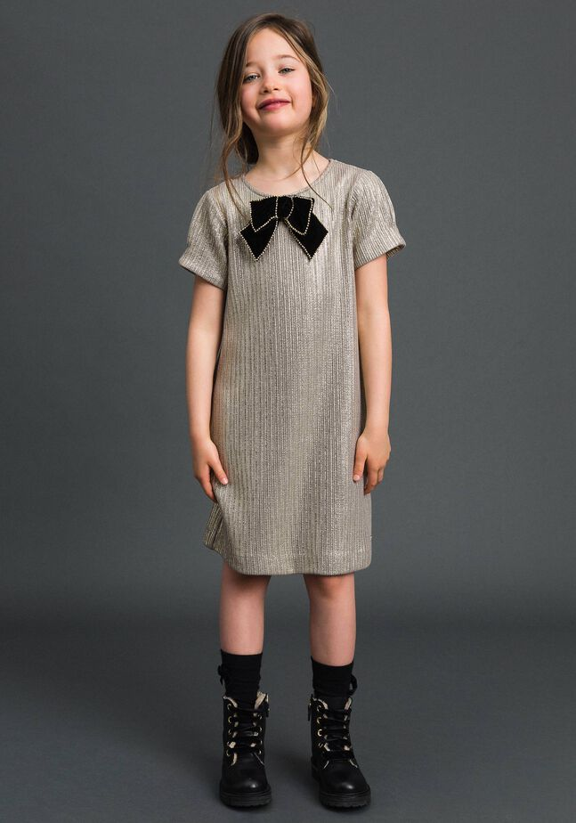 Laminated knit dress with brooch