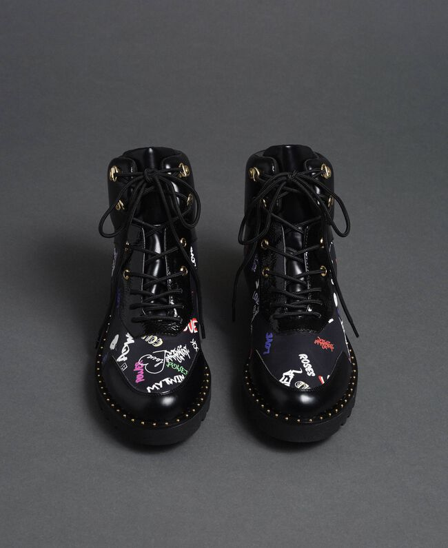 Faux leather combat boots with graffiti print Black Graffiti Print Woman 192MCP09G-05