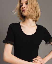 Stretched ribbed top with ruffle Black Woman 191TT3042-01