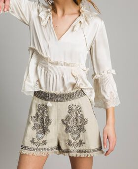 Linen shorts with beads and sequins