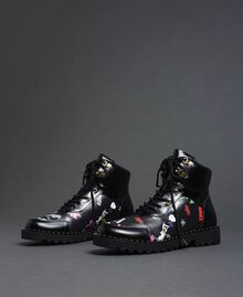 Faux leather combat boots with graffiti print Black Graffiti Print Woman 192MCP09G-01